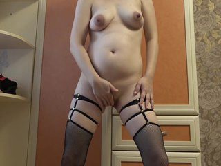 Milf at near pregnancy makes cut size of the growing tummy plus boobs, plus then masturbates a chunky pussy.